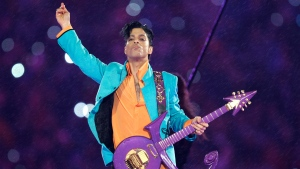In this Feb. 4, 2007, file photo, Prince performs during the halftime show at the Super Bowl XLI football game in Miami.  (AP Photo/Chris O'Meara, File)