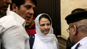 Aya Hijazi, centre, a dual U.S.-Egyptian citizen, was acquitted by an Egyptian court after nearly three years of detention over accusations related to running a foundation dedicated to helping street children, in Cairo, Sunday, April 16, 2017. Egyptian authorities arrested Hijazi, her husband and six others in May 2014 on charges of abusing children in her care and engaging in human trafficking, kidnapping, sexual exploitation and torture. (Mohamed el Raai/THE ASSOCIATED PRESSeGY)