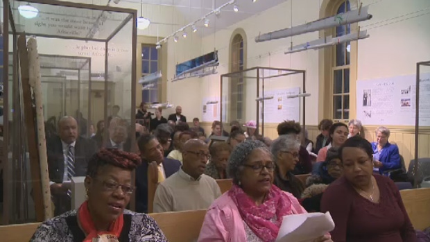 Community members gather at the Africville Museum to take part in the community's first Easter Sunday service in 50 years.