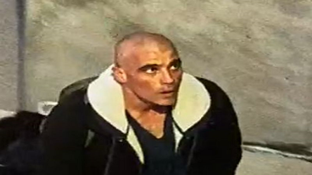 This security camera image of a suspect wanted in connection with a fire investigation at a church was released by Toronto police on Sunday, April 16, 2017.