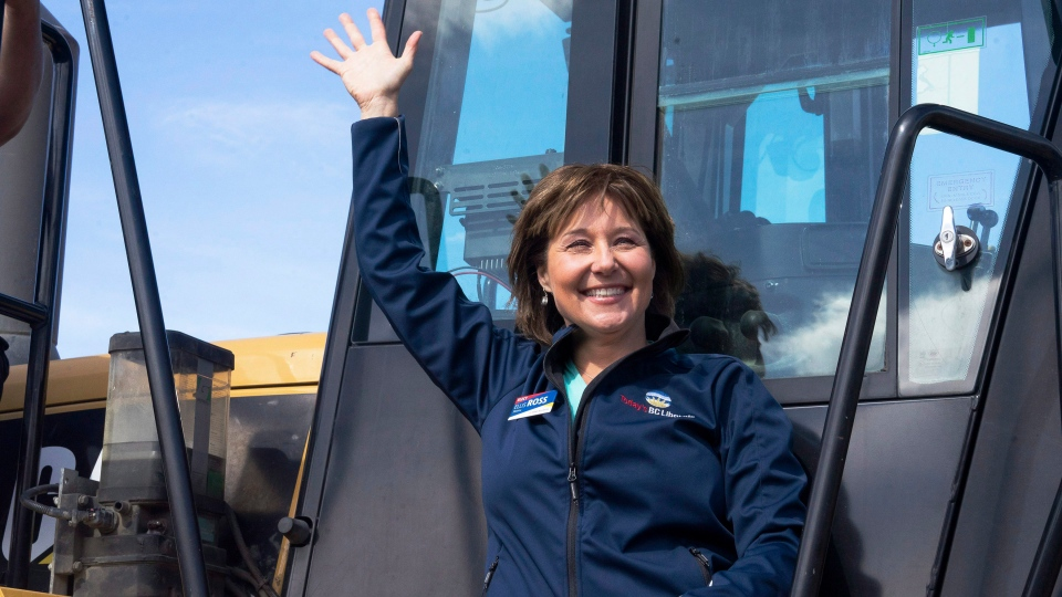B.C. Liberal Leader Christy Clark waves to supporters from a front-end loader during a campaign stop at Kentron Construction, in Kitimat, B.C. on Thursday, April 13, 2017. (Robin Rowland/The Canadian Press)