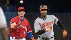 Baltimore Orioles Adam Jones is caught in a rundown between first and second base by Toronto Blue Jays shortstop Troy Tulowitzki in the fifth inning of their AL baseball game in Toronto on Sunday April 16, 2017. (Fred Thornhill/The Canadian Press)
