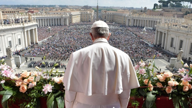 "Pope Francis addresses the crowd prior to delivering his Urbi et Orbi (to the city and to the world) message from the main balcony of St. Peter's Basilica, at the Vatican, Sunday, April 16, 2017. On Christianity's most joyful day, Pope Francis lamented the horrors generated by war and hatred, delivering an Easter Sunday message that also decried the ""latest vile"" attack on civilians in Syria. (L'Osservatore Romano/Pool Photo via AP)"