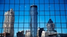 The Westin hotel, center, is reflected along with other downtown buildings in the windows of an office tower in Atlanta, Wednesday, Sept. 28, 2016. (AP Photo/David Goldman)
