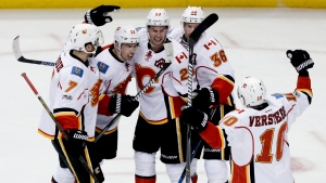 Calgary Flames celebrates after a goal by center Sean Monahan (23) against the Anaheim Ducks during the second period in Game 2 of a first-round NHL hockey Stanley Cup playoff series in Anaheim, Calif., Saturday, April 15, 2017. (Chris Carlson/AP Photo)