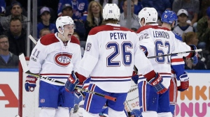 Montreal Canadiens' Artturi Lehkonen, right, celebrates with Brendan Gallagher, left, and Jeff Petry (26) after scoring during the second period in Game 3 of an NHL hockey first-round playoff series against the New York Rangers, Sunday, April 16, 2017, in New York. (AP Photo/Seth Wenig)