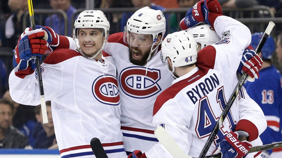 Montreal Canadiens' Shea Weber, center, celebrates with teammates after scoring during the third period in Game 3 of an NHL hockey first-round playoff series against the New York Rangers, Sunday, April 16, 2017, in New York. The Canadiens defeated the Rangers 3-1. (AP Photo/Seth Wenig)