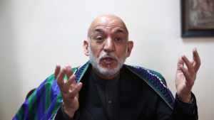 Former Afghan President Hamid Karzai speaks during an interview with the Associated Press in Kabul, Afghanistan, Monday, April 17, 2017. (AP Photo/Rahmat Gul)