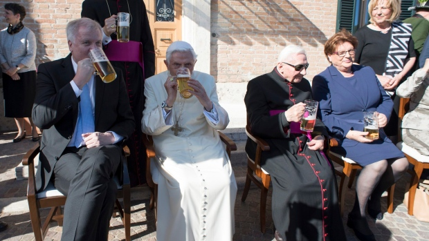 From left, Bavarian Prime Minister Horst Seehofer, Pope Emeritus Benedict XVI and his brother Georg have a glass of beer on the occasion of a party for Benedict's 90th birthday, at the Vatican Monday, April 17, 2017. His aide, Monsignor Georg Gaenswein, said Benedict's birthday, which falls on Easter Sunday this year, will be celebrated on Monday in Bavarian style in keeping with the emeritus pontiff's roots. (L'Osservatore Romano/Pool Photo via AP)