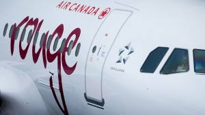 An Air Canada Rouge plane prepares for a flight to Las Vegas at Vancouver International Airport in Richmond, B.C., on Monday, April 28, 2014. (THE CANADIAN PRESS/Darryl Dyck)