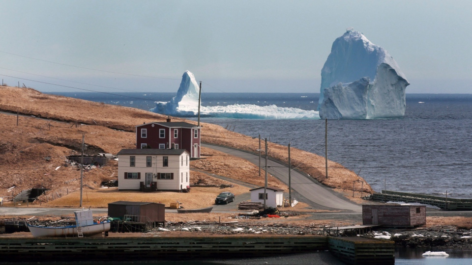 A large iceberg is visible from the shore in Ferryland, an hour south of St. John's, Newfoundland on Monday, April 10, 2017. (THE CANADIAN PRESS/Paul Daly)