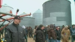 Auction for retiring farmer draws hundreds