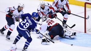 Toronto Maple Leafs right wing William Nylander scores on Washington Capitals goalie Braden Holtby as Brett Connolly, Andre Burakovsky , Kevin Shattenkirk and Lars Eller look on during second period NHL hockey round one playoff action in Toronto on Monday, April 17, 2017. (Frank Gunn / THE CANADIAN PRESS)