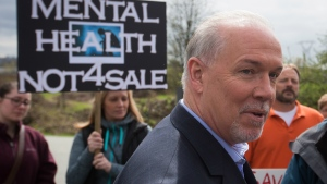 British Columbia NDP Leader John Horgan speaks to supporters after an announcement about mental health and addiction services during a campaign stop at the Riverview Lands, the former site of a mental health facility, in Coquitlam, B.C., on Monday April 17, 2017. A provincial election will be held on May 9. THE CANADIAN PRESS/Darryl Dyck