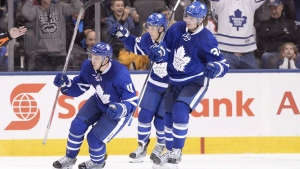 Toronto Maple Leafs' Zach Hyman (11) Auston Matthews (34) and William Nylander (39) celebrate a goal during the third period of NHL hockey pre-season action against the Montreal Canadiens in Toronto on October 2, 2016. (Frank Gunn/The Canadian Press)