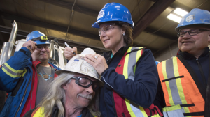 Liberal leader Christy Clark signs a worker's helmet as she makes a campaign stop at Inland Concrete in Fort St. John, B.C. on April 18, 2017. (THE CANADIAN PRESS/Jonathan Hayward)