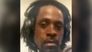 This undated photo provided by the Fresno Police Department shows Kori Ali Muhammad, 39, who was arrested shortly after a shooting rampage outside a Catholic Charities building, in Fresno, Calif. on Tuesday, April 18, 2017. (Fresno Police Department)