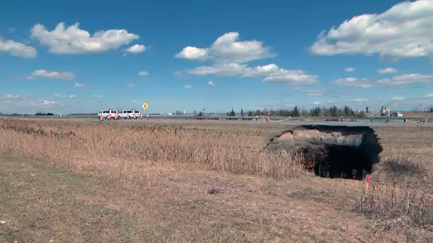 This sinkhole on Highway 25 is seven metres deep and nine metres wide