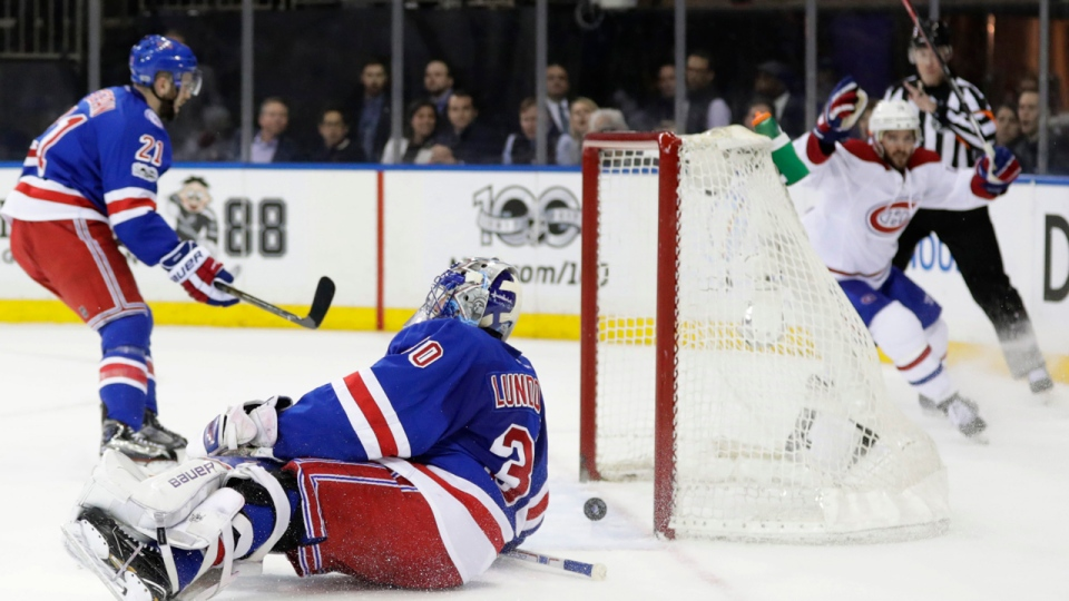 Torrey Mitchell, in background, celebrates after scoring on New York Rangers goalie Henrik Lundqvist (AP Photo/Frank Franklin II)