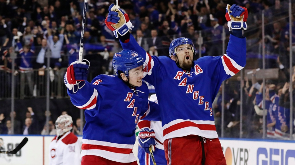 Rick Nash and Jimmy Vesey celebrate Nash's goal against the Canadiens on April 18, 2017 (AP Photo/Frank Franklin II)