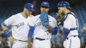 Toronto Blue Jays starting pitcher Marcus Stroman waits on mound with catcher Russell Martin and Justin Smoak for manager John Gibbons coming to take him out of the game in the fifth inning of their AL baseball game against the Boston Red Sox in Toronto on Tuesday, April 18, 2017. THE CANADIAN PRESS/Fred Thornhill