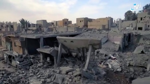Image made from militant video posted online on April 18, 2017 by the Aamaq News Agency, purports to show destroyed houses following a U.S.-led coalition strike in the eastern Syrian town of Boukamal. (Aamaq News Agency via AP)