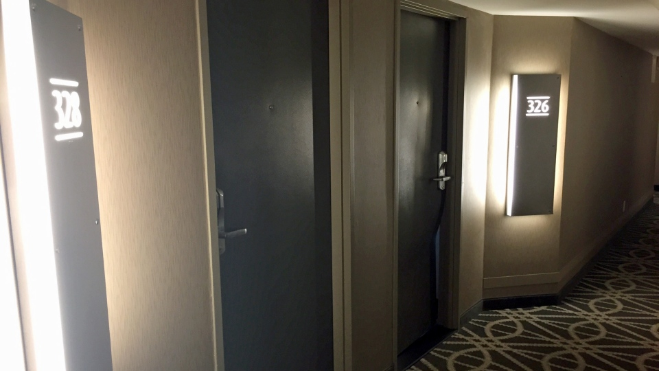 The door to a suite at the Saskatoon Inn appears kicked in after reports of gunshots Wednesday, April 19, 2017. (Blair Farthing/CTV Saskatoon)