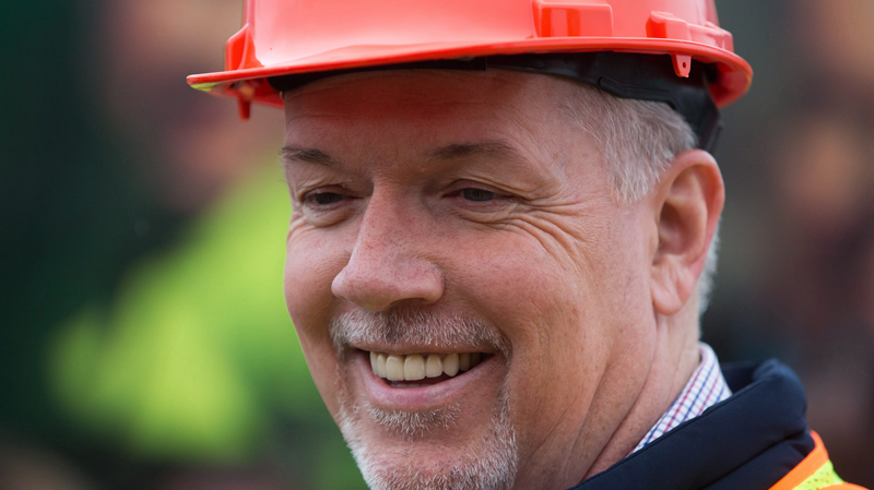 NDP leader John Horgan wears a hard hat during a campaign stop at the International Union of Operating Engineers Local 115 Training Centre in Maple Ridge, B.C., on April 18, 2017. (THE CANADIAN PRESS/Darryl Dyck)