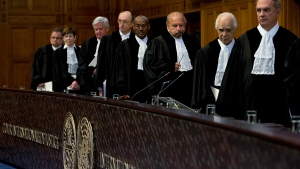 Presiding judge Ronny Abraham of France, third from right, and other judges enter the World Court which delivered its order on provisional measures in The Hague, Netherlands, Wednesday, April 19, 2017, in the case brought by the Ukraine against Russia accusing Moscow of financing separatist rebels and racially discriminating against ethnic Tartars and Ukrainians in the annexed Crimea peninsula. (AP / Peter Dejong)