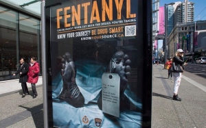 An anti-fentanyl advertisment is seen on a sidewalk in downtown Vancouver, Tuesday, April, 11, 2017. (THE CANADIAN PRESS/Jonathan Hayward)