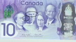 The Bank of Canada's commemorative $10 banknote is shown during the unveiling ceremony in Ottawa on April 7, 2017. (Justin Tang/The Canadian Press)