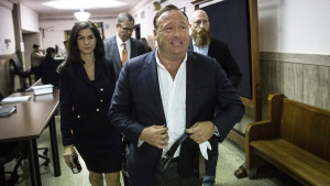 Alex Jones arrives at the Travis County Courthouse in Austin, Texas, on April 17, 2017. (Tamir Kalifa / Austin American-Statesman)