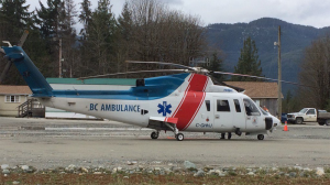 An air ambulance waits to transport patients involved in a train derailment on Vancouver Island on April 20, 2017. (Gord Kurbis)