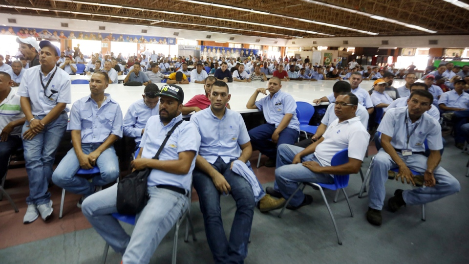 General Motors workers listen during a meeting with government officials in Valencia, Venezuela, on April 20, 2017. (Juan Carlos Hernandez / AP)