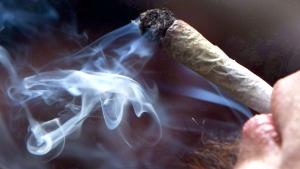 A young man smoking marijuana at a rally in Vancouver, B.C., on April 20, 2011. (Darryl Dyck / THE CANADIAN PRESS)