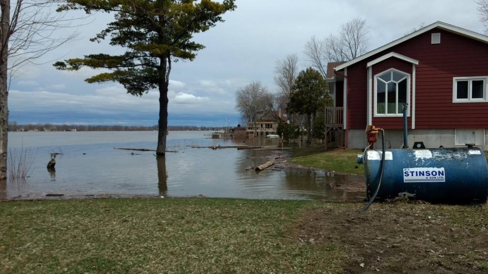 The Ottawa river is bursting its banks and flooding properties on Leo Lane in Cumberland. The neighbourhood residents are working together to protect their homes. (Christina Hajjar/Facebook)