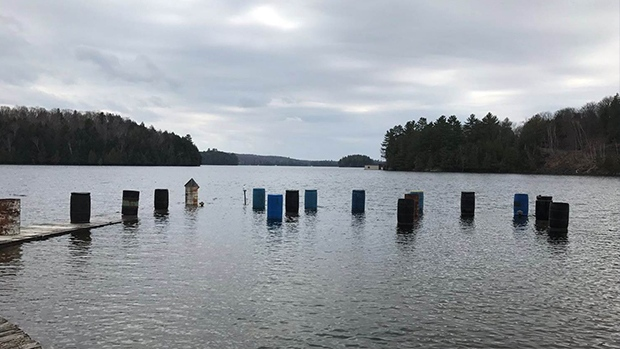 A flooded dock can be seen in Lake of Bays, Ont. on Wednesday, April 20, 2017. (BondiMaintDept/ Twitter)
