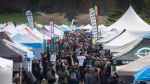 People walk between tents setup by vendors at the annual 4/20 event at Vancouver's Sunset Beach. April 20, 2017. (THE CANADIAN PRESS/Darryl Dyck)