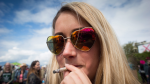 A woman smokes a joint at Vancouver's 4/20 event on April 20, 2017. (THE CANADIAN PRESS/Darryl Dyck)