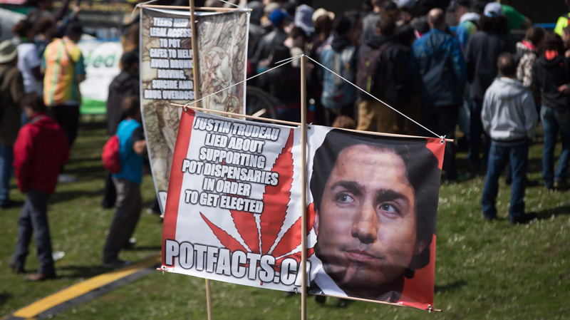A banner with a photo of Prime Minister Justin Trudeau is displayed at the annual 4/20 cannabis event in Vancouver. April 20, 2017. (THE CANADIAN PRESS/Darryl Dyck)