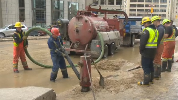 Amid rush hour, crews rushed to stop water from gushing onto the street, which created a large pool of water that closed down Main Street's southbound lane for more than two hours.