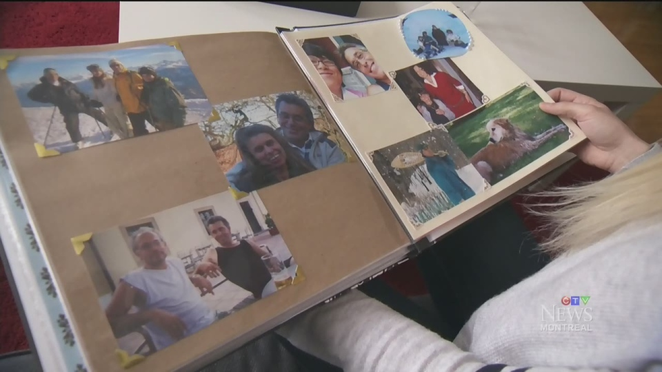 Veronica Turchetto looks at family photo albums as she remembers her late father