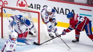 Artturi Lehkonen scores on Henrik Lundqvist during the first period of Game 5 in the Canadiens-Rangers playoff series (The Canadian Press/Paul Chiasson)