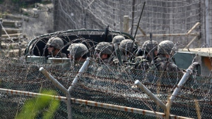 A South Korean military truck carrying soldiers moves along barbed-wire fences in Paju, South Korea, near the border with North Korea on Saturday, April 15, 2017. (AP / Ahn Young-joon)