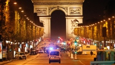 Police officer killed near Champs Elysees
