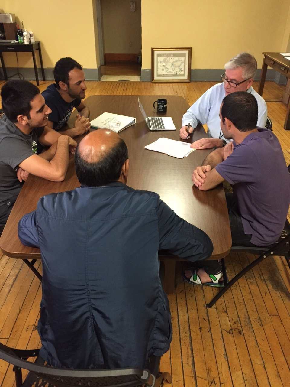 An intake volunteer talks to asylum seekers at Vive in Buffalo, New York, on Thursday, April 20. (Peter Akman / CTV News)