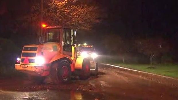 City crews are working to prevent further flood damage in neighbourhoods throughout Dundas, Ont. (CP24)