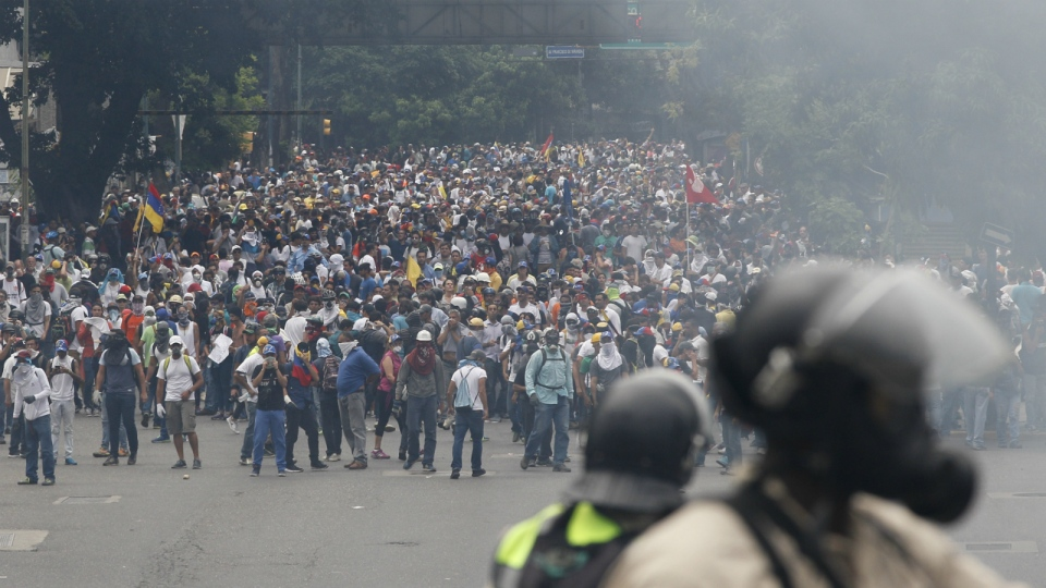 Opponents of President Nicolas Maduro march in Caracas, Venezuela on Thursday, April 20, 2017. (AP / Ariana Cubillos)