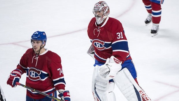 Montreal Canadiens goalie Carey Price (31) and teammate Alexei Emelin (74) skate off the ice following their overtime loss to the New York Rangers in Game 5. THE CANADIAN PRESS/Paul Chiasson