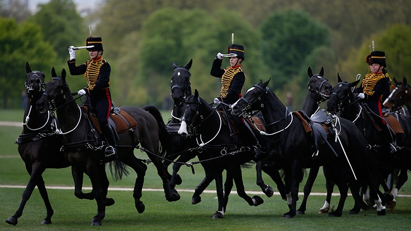 Members of the King's Troop Royal Horse Artillery take part in a ceremonial 41 gun salute in Hyde Park to mark Britain's Queen Elizabeth II 's 91st birthday, in London, Friday, April 21, 2017. (AP Photo/Alastair Grant)